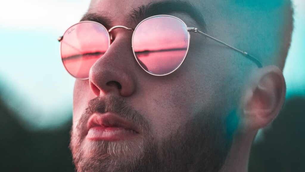 Reflections in glasses on man with beard